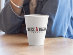 Brick & Beam logo on coffee cup